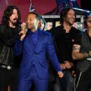 (L-R) Musicians Dave Grohl, John Legend, Rami Jaffe and Kenny Aronoff perform onstage during 'The Night That Changed America: A GRAMMY Salute To The Beatles' at the Los Angeles Convention Center on January 27, 2014 in Los Angeles, California.