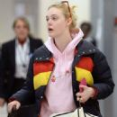 Elle Fanning – Arriving at JFK Airport in New York City