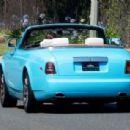 Scott Disick is seen driving around a new baby blue Rolls Royce in Calabasas, California on June 29, 2016