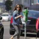 Lily Collins feeding the parking meter in Beverly Hills - 454 x 562