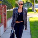 Miley Cyrus rocks a leather jacket and pants as she is spotted out and about in LA