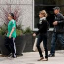 Alex Van Halen with his wife Stine and their son Malcom do some shopping around Newburry Street