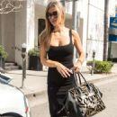 Joanna Krupa in Black Dress pumping gas in Los Angeles - 454 x 702