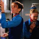 Alexandra Paul as Flight Attendant Katy Phillips in Rough Air - 454 x 341