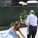 Ana De Armas – In blue summer dress gets some flowers in Brentwood