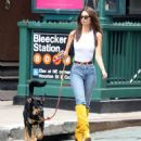 Emily Ratajkowski in Jeans and Yellow Boots – Walking her dog in NYC
