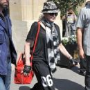 Madonna heading to her performance at Olympia in London (July 26)