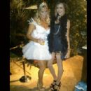 Nikki Sixx's gorgeous model girlfriend Courtney Bingham (right) decided on a Black Swan theme for Halloween. What a babe!