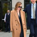 Emilia Clarke in Brown Coat – Out and about in New York