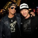 Musician Slash (L) and actor Clifton Collins Jr. pose at the after party for the premiere of FilmDistrict's 'Insidious: Chapter 2' at Jurassic Park Universal Studios on September 10, 2013 in Universal City, California.