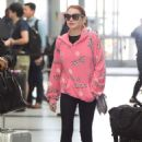 Lindsay Lohan in Tights – JFK Airport in New York - 454 x 681