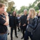 Prince Harry with singer Dave Grohl and drummer Taylor Hawkins of the Foo Fighters attend an Invictus Games Reception at the American Ambassador's Residence, Winfield House on September 9, 2014 in London, England.
