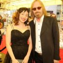 Regina Spektor and Tom Petty pose together after arriving at the MTV Video Music Awards