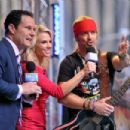 'FOX & Friends' co-hosts Brian Kilmeade and Elizabeth Hasselbeck talk to singer/TV personality Bret Michaels after his performance on 'FOX & Friends' All American Concert Series outside of FOX Studios on July 18, 2014 in New York City.
