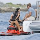Kendall Jenner and Kourtney Kardashian in Swimsuit on a yacht in Cannes - 454 x 303