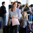 Marcia Cross and family seen at LAX