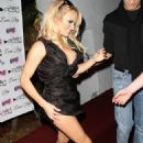 Pamela Anderson - Play Night Club To Pose On The Red Carpet In Miami, 2 February 2010