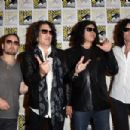 Kiss attends the Scooby-Doo! and Kiss: Rock and Roll Mystery Press Room during Comic-Con International 2015 at the at Hilton Bayfront on July 9, 2015 in San Diego, California. - 454 x 303