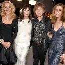 A VERY modern family! Sir Mick Jagger is joined by model daughters Georgia May and Elizabeth, ex-wife Jerry Hall and her new husband Rupert Murdoch at Vanity Fair Oscars party