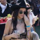 Kendall Jenner rocks a sheer bra while hanging out at the Bootsy Bellows Pool Party at the 2016 Coachella Music Festival April 16, 2016