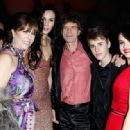 Mick Jagger and L'Wren Scott arrive at the Vanity Fair Oscar party hosted by Graydon Carter held at Sunset Tower on February 27, 2011 in West Hollywood, California - 454 x 317