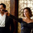 "(L-r) KEN WATANABE as Saito and MARION COTILLARD as Mal in Warner Bros. Pictures' and Legendary Pictures' sci-fi action film ""INCEPTION,"" a Warner Bros. Pictures release. Photo by Melissa Moseley"