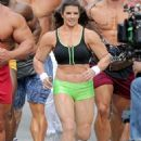 Danica Patrick displays bulky frame to film Super Bowl commercial..... but it's just a muscle suit - 454 x 593