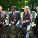 Eric Lamonsoff (Kevin James), Kurt McKenzie (Chris Rock), Marcus Higgins (David Spade) and Lenny (Adam Sandler) talk at the reception following their coaches memorial service in Columbia Pictures' GROWN UPS. Photo By: Tracy Bennett. ©2009 Columbia Tri