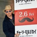 Johnny Depp attends the photo call for