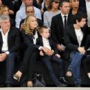 Sharon Stone takes her youngest son Quinn Kelly Stone (b. 2006) to the Dior Homme Spring/Summer 2013 menswear fashion show during Paris Fashion Week