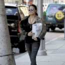 Michelle Rodriguez in Ripped Jeans Out Shopping in Beverly Hills - 454 x 605