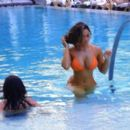 Daphne Joy – In a orange bikini at the pool in Miami - 454 x 265
