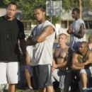 'The Rock' (l) and Xzibit star in Columbia Pictures' drama Gridiron Gang. Photo Credit: John Bramley