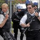 Simon Pegg as Nicholas Angel with his partner Nick Frost as Danny Butterman in action comedy 'Hot Fuzz' 2007
