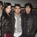 Joe Jonas attended the HUDSON Jeans Invades SCOOP NYC For A Phosphorescent Invasion  event last night, February 10