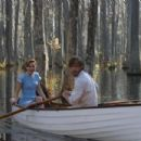 "Rachel McAdams (left) stars as ""Allie"" and Ryan Gosling (left) stars as ""Noah"" in New Line Cinema's epic story of love lost and found, THE NOTEBOOK."