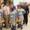 A Scene from The Perfect Game featuring (from left to right) Angel (Jake T. Austin), Cesar (Clifton Collins Jr.), Mario (Moises Arias), Gerando (Mario Quinonez), Enrique (Jansen Panettiere), Reverend Clarence (Louis Gossett Jr.) and Frankie (Emilie de Rav