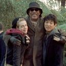 Kerry Condon (left), Morgan Freeman (center), and Jet Li (right) star in Louis Leterrier's UNLEASHED, a Rogue Pictures release.