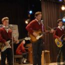 John C. Reilly (center), as Dewey Cox, leads the band (from left: Christopher Hurt, Aron Johnson, Taylor Hubert, Jack Saperstein) in Columbia Pictures' Walk Hard: The Dewey Cox Story. Photo Credit: Gemma Lamana. © 2007 Columbia Pictures Industries, - 454 x 303