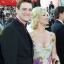 Jim Carrey and Lauren Holly At The 69th Annual Academy Awards (1997) - 293 x 502