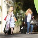Dakota and Elle Fanning–Checking out of a hotel together in LA