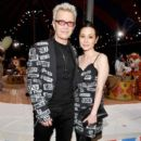 China Chow and Billy Idol attend the Moschino Spring/Summer 19 Menswear and Women's Resort Collection at Los Angeles Equestrian Center on June 8, 2018 in Burbank, California - 399 x 600