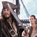 Johnny Depp and Orlando Bloom of Walt Disney's Pirates Of The Caribbean: The Curse of the Black Pearl - 2003