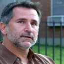 ANTHONY LAPAGLIA as Leo, in the title role of THE ARCHITECT, a new film about an idealistic architect who is confronted by an outspoken activist and mother living in a dangerous housing project of his design, seeking his damning signature on a petition to