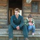 Jerry (Jamie Draven) and his daughter Celina (Grace Fulton) on farmhouse steps. Photo Credit: © 2007 Badland Corporation