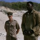 Joseph Fiennes as James and Dennis Haysbert as Nelson Mandela in Goodbye Bafana.
