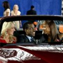 Car show model and Chris Rock with Kerry Washington in I THINK I LOVE MY WIFE. Photo Credit: Phil Caruso