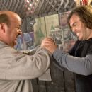 Jack Black as JB and Kyle Gass as KG in action with cafe setting.