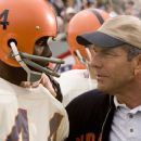 (L to R) Ernie Davis (ROB BROWN) receives a pep talk from Coach Ben Schwartzwalder (DENNIS QUAID) in a drama based on the incredible true story that follows the inspirational life of college football hero Davis—The Express. Credit: Chuck Hodes