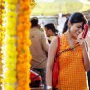 Shriya Saran star as Priya Sethi with phone in Metro-Goldwyn-Mayer 'The Other End of the Line.'